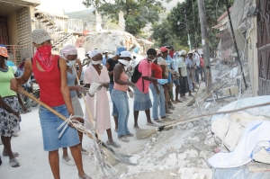 Haitian women clear debris from the roads after the 2010 earthquake.