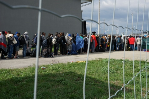 a_line_of_syrian_refugees_crossing_the_border_of_hungary_and_austria_on_their_way_to_germany-_hungary_central_europe_6_september_2015